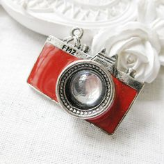 red camera metal charm