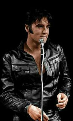 Elvis wearing the iconic black leather suit..1968 Comeback TV Special.