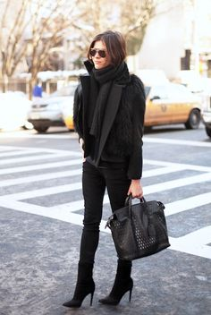 Emily Weiss hits it out of the park in an all-black ensemble, one of her go-to looks. Obsessing over how she added in more detail by layering a black fur vest over her coat and adding in a perforated handbag. Her aviators and chunky scarf ties the entire look together.