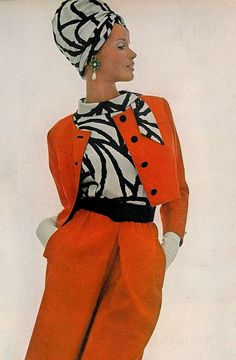 Veruschka in a tomato-red twill suit worn with a black & white printed blouse by David Kidd for Jablow and earrings by Hattie Carnegie, photo by Bert Stern for Vogue, 1965