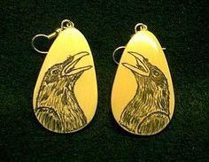 ivory scrimshaw raven...