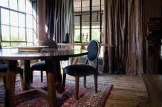 The Pierre Cronje showroom in Wynberg, Cape Town - Wolfe st, Chelsea Village. (Karoo round dining table with Sandton chairs) Round Dining Table, Dining Chairs, Fine Furniture, Showroom, Flooring, Curtains, Interior Design, Cape Town, Furnitures