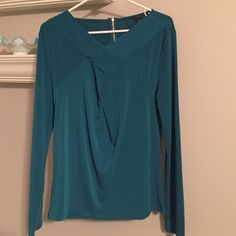 """NWOT Ann Taylor drape front blouse Rich jewel toned top with crossover detail at neck and exposed gold tone zipper. Only tried on, but never worn as it was too tight on me. 25"""" long from back neckline. Sleeves 23.5"""" Ann Taylor Tops Blouses"""