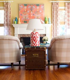 Ikat lamp, Paule Marrot artwork, trunk, buffalo check chairs. Nice.