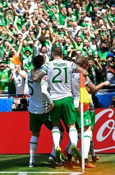 #EURO2016 Ireland's players celebrate after scoring during the Euro 2016 round of 16 football match between France and Republic of Ireland at the Parc...