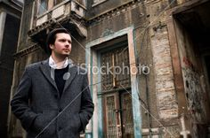Attractive man walking in old streets Royalty Free Stock Photo