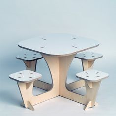 The group table by Skog Kids encourages correct posture and group play.