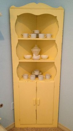 Vintage Corner Hutch-Refinished in Pastel Yellow, distressed-  White dinnerware and vintage milk glass dishes