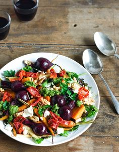 Roast root vegetable salad with feta & semi-dried tomatoes & walnut, parsley & basil pesto