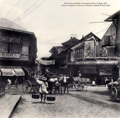 Street scene in Binondo, the business district of Manila, 1901 Historical Landmarks, Historical Photos, Historical Fiction, Philippines Culture, Ancient Greek Architecture, Beautiful Buildings, Manila, History, Filipino