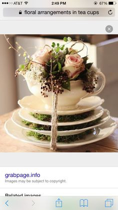 Stacked plates with teapot floral arrangement for centerpiece