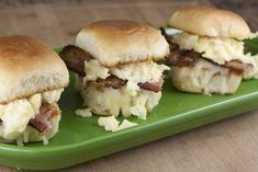 Bacon, eggs, and cheese stuffed into a small slider roll makes for a fun and tasty breakfast dish.