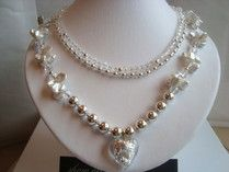 Designed & Handmade Stunning Icy Three strand necklace - Beautiful Freshwater Pearls, sliding on Icy sterling silver Beads, Swarovski Crystals Shinning like diamonds around a Glass Heart Shape Sterling silver inset  on Ice. Showoffjewels feel the freeze then let it warm your Heart this Christmas !