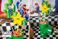 DIY Super Mario green sewers made from pvc pipes and spray painted green.  Top with chocolate lollipops! www.partystock.ca/blog