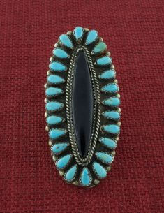 Vintage Sterling Silver Petit Point Cluster Kingman Turquoise Ring with Onyx Center Stone. Handcrafted and designed by an unrecorded Navajo artist circa the early 1970's. Available At SilverTQ.com - Offering Authentic Native American Indian Jewelry Since 1978. Free U.S. Shipping! Retail/Wholesale.