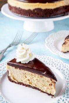 ThisPeanut Butter Chocolate Cheesecakerecipe is a silky, peanut buttery dessert sandwiched between a chocolate graham cracker crust and chocolate ganache.