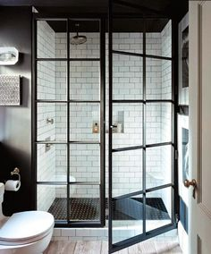 A great example of a modern farmhouse bathroom design, the glass shower enclosure really is the iconic piece of the design. Modern Farmhouse Design, Modern Farmhouse Bathroom, Rustic Farmhouse, Modern Rustic, Urban Farmhouse, Modern Luxury, Industrial Bathroom, Rustic Cottage, Farmhouse Interior