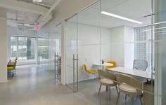 Brown Shoe Company  Designer: MKDA New York    #brownshoecompany #office #mkdanewyork #tagwall #slimline #interiordesign #officedesign #walldesign #workspaces Shoe Company, Brown Shoe, Workspaces, Wall Design, Divider, Walls, York, Interior Design, Furniture