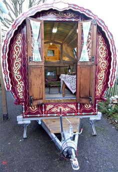 The detail of this gypsy caravan is a one of a kind home one wheels. The wood interior is rustic and pairs with the antique finish out.