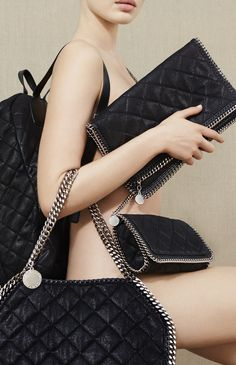 Black quilted faux suede #Falabella bag, pouch and backpack from the Stella McCartney collection