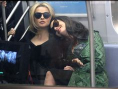 """Speaking of subways, let's talk about whatever this subway scene is that's happening. It is bound to be the most iconic subway scene in history because apparently it includes Anne Hathaway leaning on Helena Bonham Carter: 
