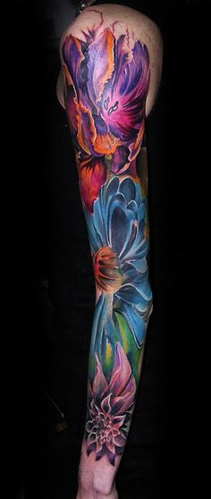 Stunning colours on this floral sleeve tattoo.