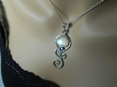 Moonstone Necklace - Rainbow Moonstone Blue Topaz Pendant -  Sterling Silver Swirl Gemstone - Moonstone Topaz Jewelry - Winter Blue Ice. $119.00, via Etsy.