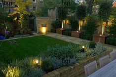 Harpur Garden Images :: gilday7 Contemporary modern minimal stylish family urban town garden with lighting light lawn brick wall water feature lip cascade bay tree Laurus nobilis low brick wall raised bed border October autumn standard Contemporary, modern, minimal, stylish, family, urban, town, garden, lighting, light, lawn, brick, wall, water, feature, lip, cascade, bay, tree, Laurus, nobilis, low, brick, wall, raised, bed,