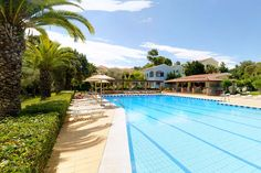 Helion Resort Gouvia Located in Gouvia, Helion Resort offers a garden and spa centre. Corfu Town is 8 km away. Free private parking is available on site. Corfu Holidays, Spa Center, Centre, Corfu Town, Outdoor Pool, Outdoor Decor, Greece Holiday, Pool Bar, Holiday Apartments