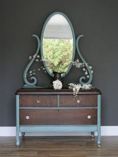 Queenie: This antique quarter sawn oak chest has it's original beveled mirror that is dated 1911 on the back and it in near perfect condition! The grain is very prominent and it has a unique rounded edge that was made way before waterfall pieces came around! Original glass knobs too! Modern Vintage