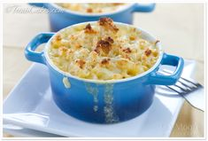 Creamy Four-Cheese Macaroni and Cheese from Saveur. Made with sharp white cheddar, Gruyere, Velveeta (!!), and blue cheese.