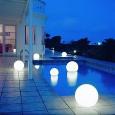 these floating pool lights would be so cool on the dock for a little midnight lake - Pool Decorations