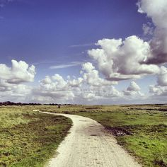 Cycling path on Schiermonnikoog island, day with clouds (The Netherlands)