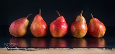 Pic: Red pears on black background