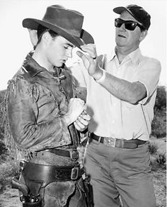 """Sorry don't get it done, Dude."" JOHN WAYNE adjusting Ricky Nelson's hat on the set of Rio Bravo."