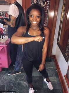 Showing off: Simone Biles, 20, has had the Olympic rings inked on her arm for her first tattoo