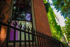 A violet-tinted window in Beacon Hill.