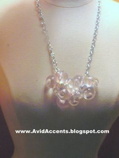 DIY necklace made from elastic hair tie balls.