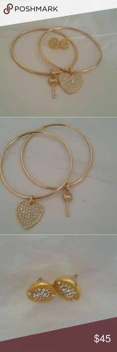 Michael kors jewelry set Two MK bracelets one is a key with crystals and MK, the other one is a heart with crystals. Stud earrings with diamond crystals Jewelry
