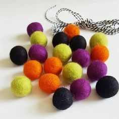 Halloween colors DIY Felt Ball Garland Kit! 20 2.5 cm Felt balls in Chartreuse, Orange, Black, and Purple, plus 3 yards of thick Black/White Striped 12-ply Bakers Twine. Perfect for Halloween decorations in any room.  This DIY kit comes with everything you need (except a needle) to make the perfect felt ball garland to adorn your mantle, door, or upcoming party! The great thing about this kit is that you can arrange the felt balls in whatever color pattern you would like. The twine is ni...