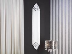Mirror made with bevelled mirrors, decorated and carved. Wood and MDF support, black finish. Inner mirror plate bevelled.