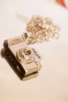 Camera Pendant Necklace. it's a Nikon, too. How perfect.