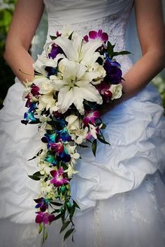 "This is a bridal ""Don't""! Never have your flower bouquet stand out more than your gown. Keep it small, as an accessory to your dress and not overpowering. You spend a lot of time and money choosing the perfect dress, so let it lead and not your bouquet! Cascading Wedding Bouquets, Cascade Bouquet, Bouquet Wedding, Bridal Bouquets, Peacock Wedding Flowers, Cascading Flowers, Perfect Wedding, Our Wedding, Dream Wedding"