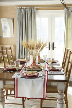 red & white tablescape with wheat stalk centerpiece