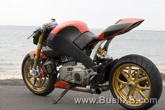 Custom Buell with single sided swing arm, dual front rotors, and crazy custom rear brake set up http://www.buellxb.com/buell_images/3732_20100513211219_L.jpg