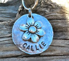 Pet ID Dog Tag Personalized and Hand Stamped ...... Daisy. $10.00, via Etsy.