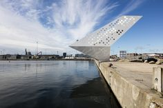 Completed in 2015 in Aarhus, Denmark. Images by Torben Eskerod. The new viewing tower and landmark on the harbour of Aarhus Ø, The Salling Tower, is shaped as a dramatic urban sculpture. Aarhus, Landscape Architecture, Interior Architecture, Parametric Architecture, Metal Facade, Lookout Tower, Construction Process, Public Art, Malaga
