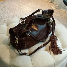 G.I.L.I all leather bag This is a beautiful bag by Gili has a shoulder strap which is removable or handbag straps approximately 19 inches across by 12.5  huge bag has a beautiful brown snake print to it  all genuine leather very soft beautiful Tassel, which you can I remove if needed magnetic closure excellent excellent condition This is such a comfortable bag to carry it is just perfect G.I.L.I  Bags
