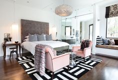 This luxurious bedroom with bold accents was completed by Lucinda Loya Interiors. #luxeHouston
