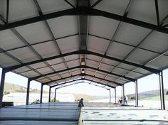 The team from Rig-Tech Steel Structures installing IsoBoard over Purlin at Spar Underberg. Another happy customer.